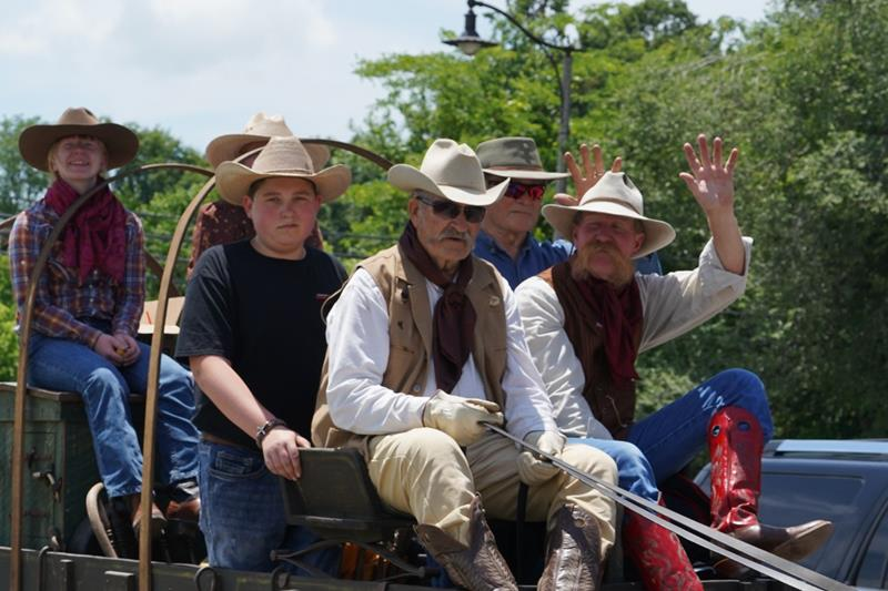 Cowboys on Wagon